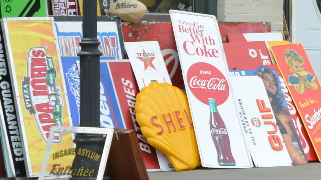 Vintage signs outside Attic Treasures Antiques in Watkinsville